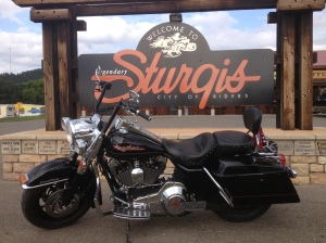 V-Twin Life - Road King at the Sturgis sign